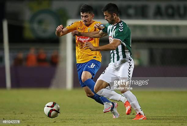 Estoril Praia's forward Billal with Vitoria Setubal's defender Dani in action during the Primeira Liga match between Vitoria Setubal and GD Estoril...