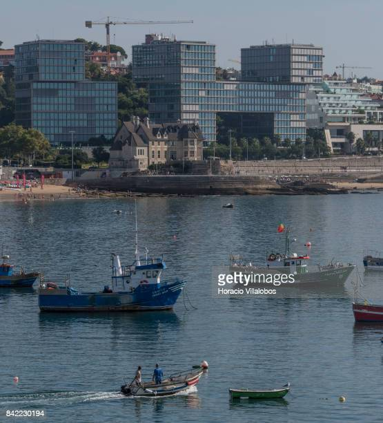 Estoril Sol Residence a 14story condominium building facing the sea near Praia das Moitas is seen from the fishermen's harbor on August 23 2017 in...