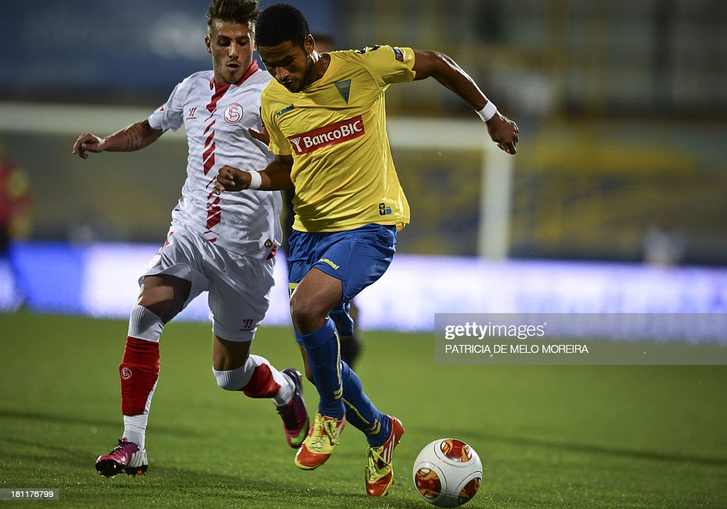 Estoril's Cape Verdean defender Elvis Macedo 'Babanco' (R) vies with Sevilla's Portuguese defender Diogo Figueiras (L) during the UEFA Europa League, group H, football match Estoril vs Sevilla at the Antonio Coimbra da Mota stadium in Estoril on September 19, 2013. AFP PHOTO/ PATRICIA DE MELO MOREIRA