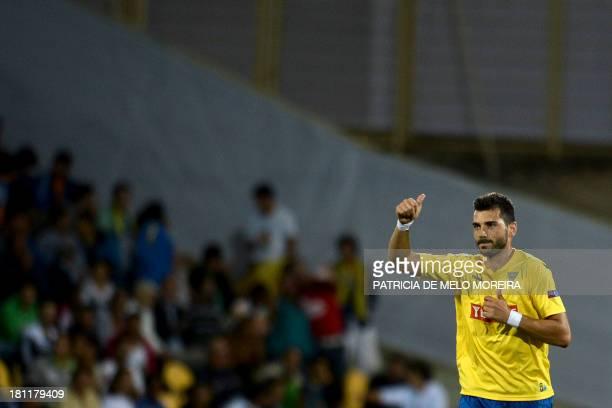 Estoril's defender Bruno Miguel celebrates after scoring during the UEFA Europa League group H football match Estoril vs Sevilla at the Antonio...