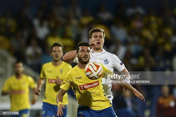 Estoril's defender Bruno Miguel vies with Dinamo Moskva's forward Aleksandr Kokorin during the UEFA Europa League Group E football match Estoril...