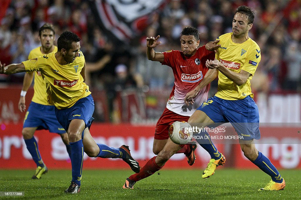 Estoril's defender Yohan Tavares (R) vies with Freiburg's French defender Francis Coquelin (2nd R) during the UEFA Europa League group H football match Estoril vs SC Freiburg at the Antonio Coimbra da Mota stadium on November 7, 2013.