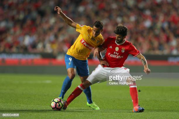 Estoril's forward Bruno Gomes from Brazil vies with Benfica's defender Lisandro Lopez from Argentina during the match between SL Benfica and Estoril...