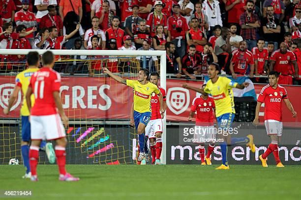 Estoril's forward Kleber celebrates scoring Estoril«s second goal during the Primeira Liga match between GD Estoril Praia and SL Benfica at Estadio...
