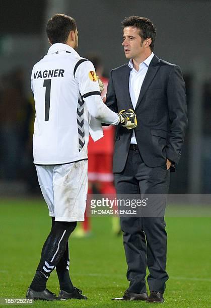 Estoril's head coach Marco Silva talks with his Brazilian goalkeeper Vagner after the UEFA Europa League Group H football match SC Freiburg vs...