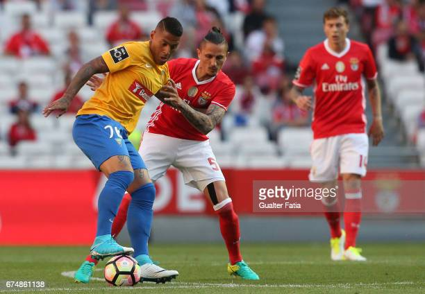 Estoril's midfielder Carlinhos from Brazil with SL Benfica's midfielder from Serbia Ljubomir Fejsa in action during the Primeira Liga match between...
