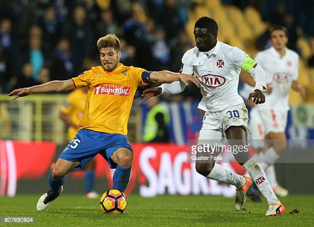 Estoril's midfielder Diogo Amado from Portugal with Belenenses's forward Abel Camara from Portugal in action during the Primeira Liga match between...