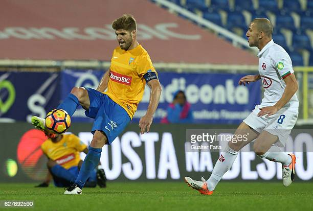 Estoril's midfielder Diogo Amado from Portugal with Belenenses's midfielder Andre Sousa from Portugal in action during the Primeira Liga match...