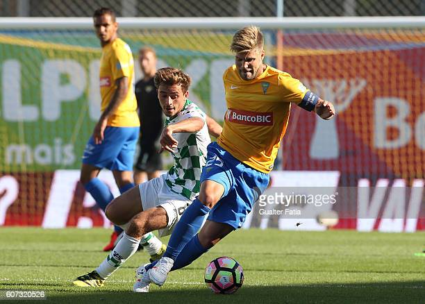 Estoril's midfielder Diogo Amado from Portugal with Moreirense«s midfielder Francisco Geraldes in action during the Primeira Liga match between GD...