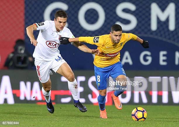 Estoril's midfielder Eduardo Teixeira from Brazil with Belenenses's midfielder Joao Palhinha from Portugal in action during the Primeira Liga match...