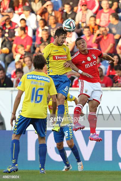 Estoril's midfielder Filipe Goncalves and Benfica's forward Lima in action during the Primeira Liga match between GD Estoril Praia and SL Benfica at...