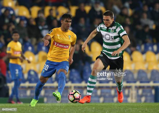 Estoril's midfielder Matheus Indio from Brazil with Sporting CP's midfielder Joao Palhinha from Portugal in action during the Primeira Liga match...