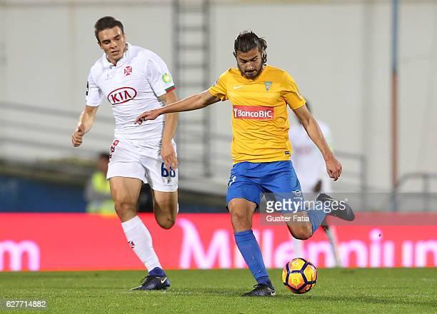 Estoril's midfielder Mattheus Bebeto from Brazil with Belenenses's midfielder Joao Palhinha from Portugal in action during the Primeira Liga match...