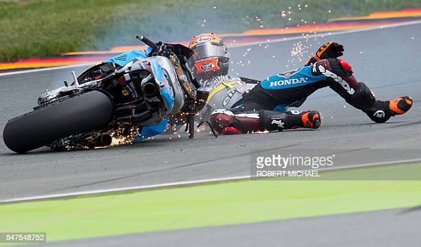 TOPSHOT Estrella Galicia 00 Marc VDS's Spanish rider Tito Rabat falls during the second training session of the Moto GP of the Grand Prix of Germany...