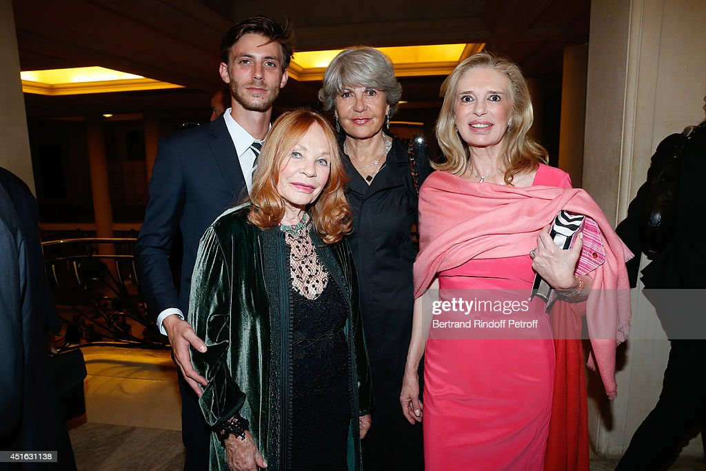 Etchika Rheims (2nd L), her Grandson (L), Barbara Hennessy (R) and Agnes de la Rive (2nd R) attend the '20th Amnesty International France' : Gala 'Music against oblivion'. Held at Theatre des Champs-Elysees on July 2, 2014 in Paris, France.