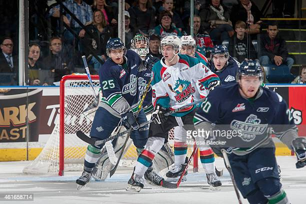 Ethan Bear of Seattle Thunderbirds back checks Cole Linaker of Kelowna Rockets during third period on January 16 2015 at Prospera Place in Kelowna...
