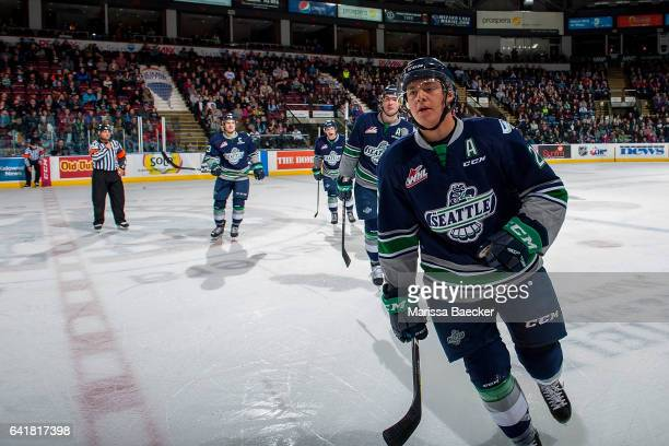Ethan Bear of the Seattle Thunderbirds skates to the bench to celebrate a goal against the Kelowna Rockets on February 13 2017 at Prospera Place in...