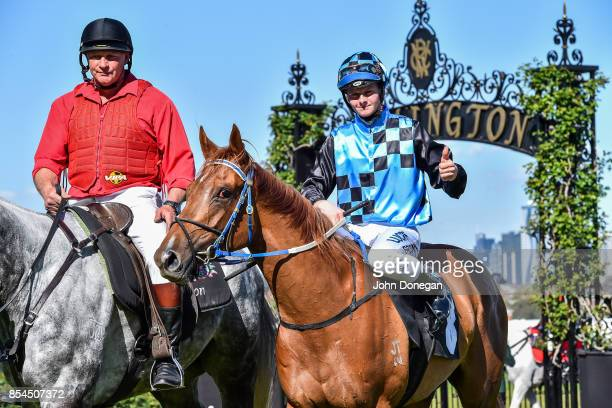 Ethan Brown returns to the mounting yard aboard Divine Messenger after winning the Have You RSVP'd Handicap at Flemington Racecourse on September 27...