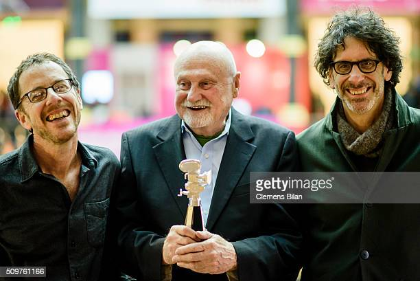 Ethan Cohen Ben Barenholtz and Joel Cohen attend a photocall after the award ceremony during the 66th Berlinale International Film Festival Berlin at...