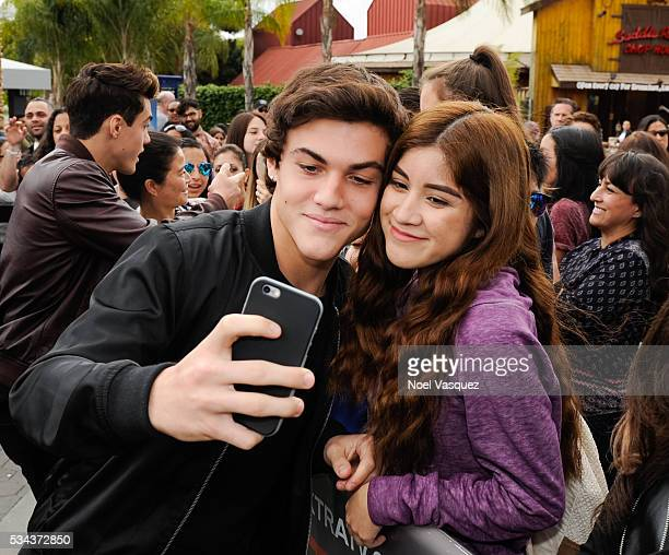 Ethan Dolan takes a selfie with a fan at 'Extra' at Universal Studios Hollywood on May 25 2016 in Universal City California