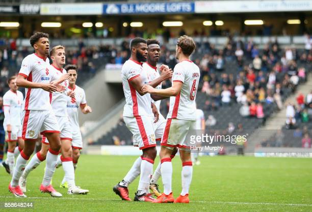 Ethan EbanksLandell of Milton Keynes Dons celebrates scoring his teams opening goal with teammates during the Sky Bet League One match between Milton...
