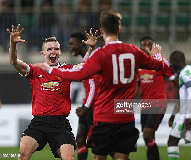 Ethan Hamilton and Callum Gribbin of Manchester United U19s celebrate Axel Tuanzebe scoring their first goal during the UEFA Youth League match...