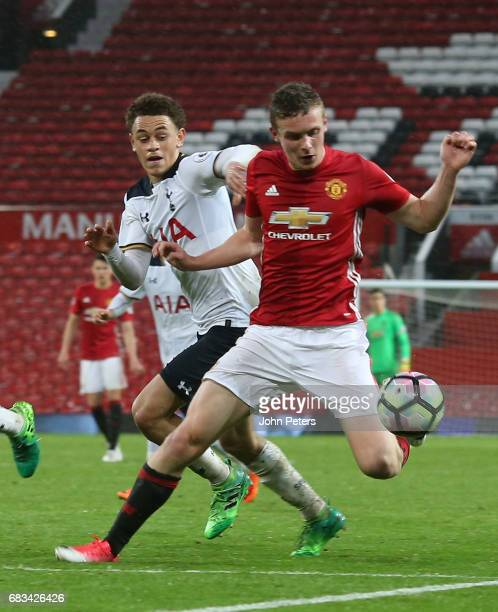 Ethan Hamilton of Manchester United U23s in action with Luke Amos of Tottenham Hotspur during the Premier League 2 match between Manchester United...