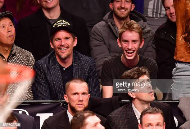 Ethan Hawke and Levon ThurmanHawke attend New York Knicks Vs Brooklyn Nets game at Barclays Center on March 12 2017 in New York City