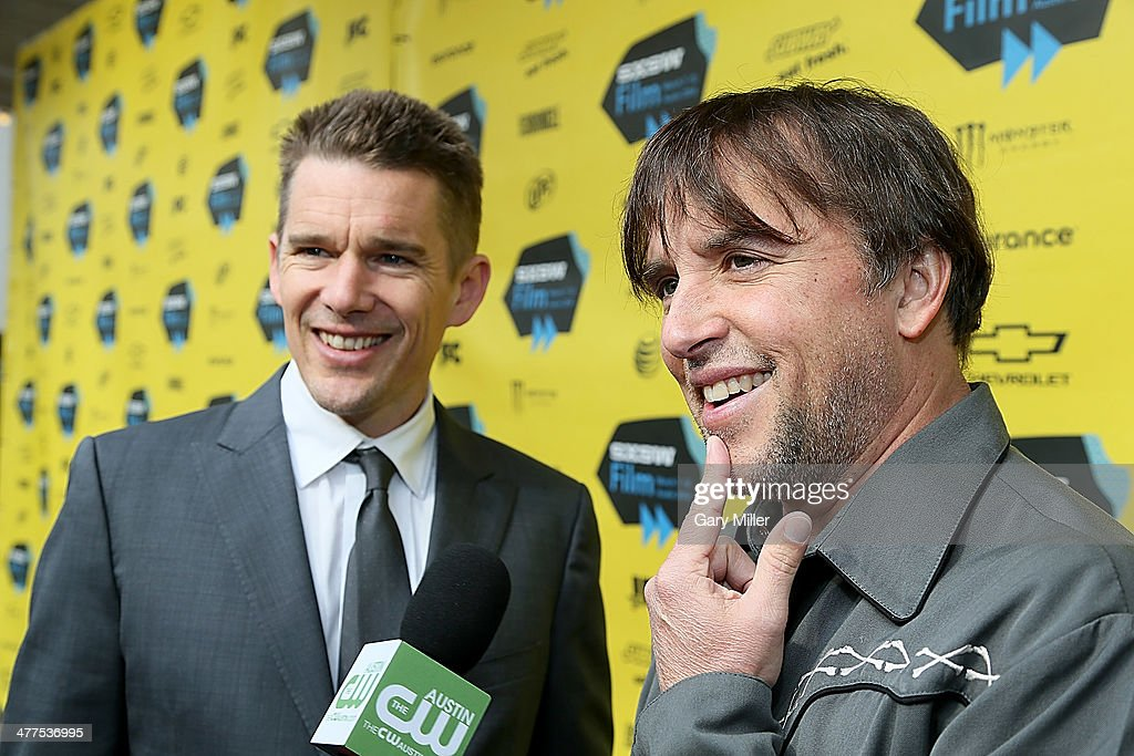 <a gi-track='captionPersonalityLinkClicked' href=/galleries/search?phrase=Ethan+Hawke&family=editorial&specificpeople=178274 ng-click='$event.stopPropagation()'>Ethan Hawke</a> (L) <a gi-track='captionPersonalityLinkClicked' href=/galleries/search?phrase=Richard+Linklater&family=editorial&specificpeople=242770 ng-click='$event.stopPropagation()'>Richard Linklater</a> walk the red carpet for the premiere of the new film 'Boyhood' during the South By Southwest Film Festival on March 9, 2014 in Austin, Texas.