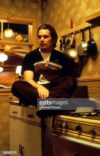 Ethan Hawke sits on a counter in a scene from the film 'Reality Bites' 1994