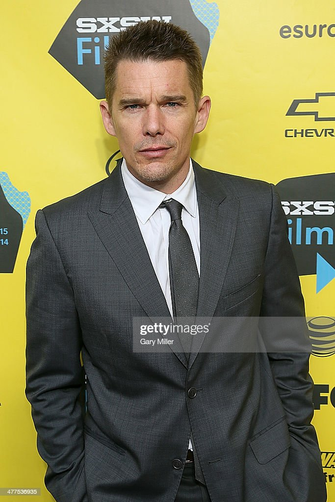 <a gi-track='captionPersonalityLinkClicked' href=/galleries/search?phrase=Ethan+Hawke&family=editorial&specificpeople=178274 ng-click='$event.stopPropagation()'>Ethan Hawke</a> walks the red carpet for the premiere of his new film 'Boyhood' during the South By Southwest Film Festival on March 9, 2014 in Austin, Texas.