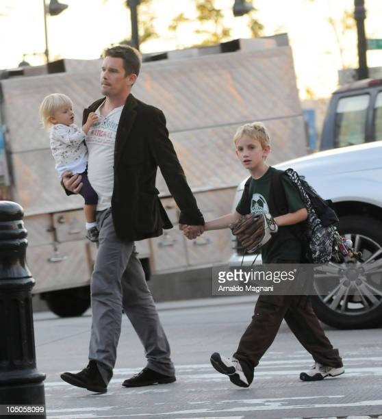 Ethan Hawke walks with his daughter Clementine Jane Hawke and son Levon Roan ThurmanHawke in Midtown Manhattan on October 7 2010 in New York City