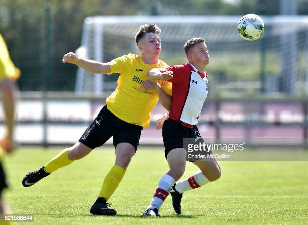 Ethan Hill of Southampton and Christopher McKee of County Antrim during the NI Super Cup junior section game between Southampton and County Antrim at...