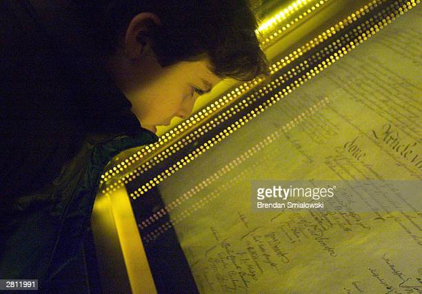 Ethan Kasnett an 8th grade student at the Lab School in Washington DC views the original constitution after a ceremony unveiling the people's choice...