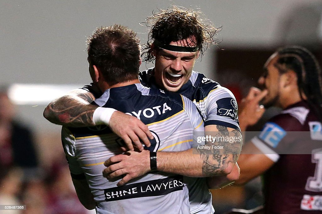 Ethan Lowe of the Cowboys celebrates a try from Kyle Feldt during the round nine NRL match between the Manly Sea Eagles and the North Queensland Cowboys at Brookvale Oval on April 30, 2016 in Sydney, Australia.