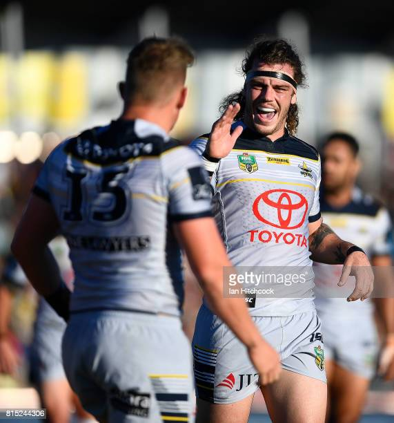 Ethan Lowe of the Cowboys celebrates with Coen Hess of the Cowboys after he scored a try during the round 19 NRL match between the South Sydney...