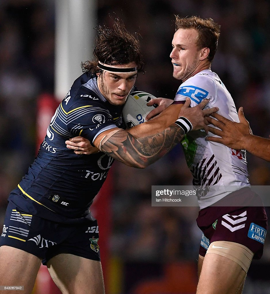 Ethan Lowe of the Cowboys is tackled by <a gi-track='captionPersonalityLinkClicked' href=/galleries/search?phrase=Daly+Cherry-Evans&family=editorial&specificpeople=7594603 ng-click='$event.stopPropagation()'>Daly Cherry-Evans</a> of the Sea Eagles during the round 16 NRL match between the North Queensland Cowboys and the Manly Sea Eagles at 1300SMILES Stadium on June 27, 2016 in Townsville, Australia.
