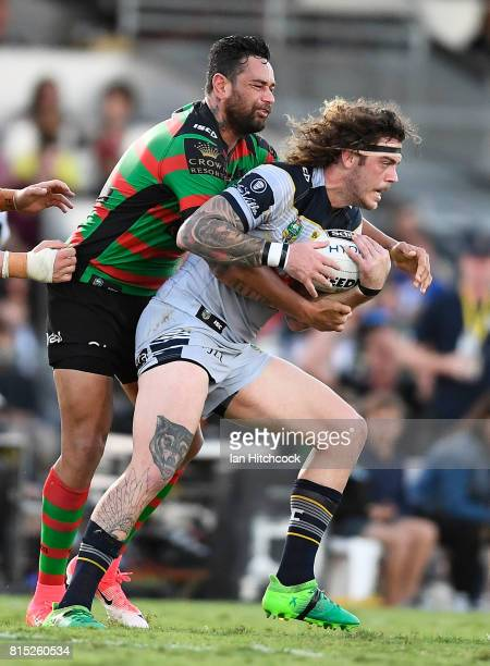 Ethan Lowe of the Cowboys is tackled by John Sutton of the Rabbitohs during the round 19 NRL match between the South Sydney Rabbitohs and the North...