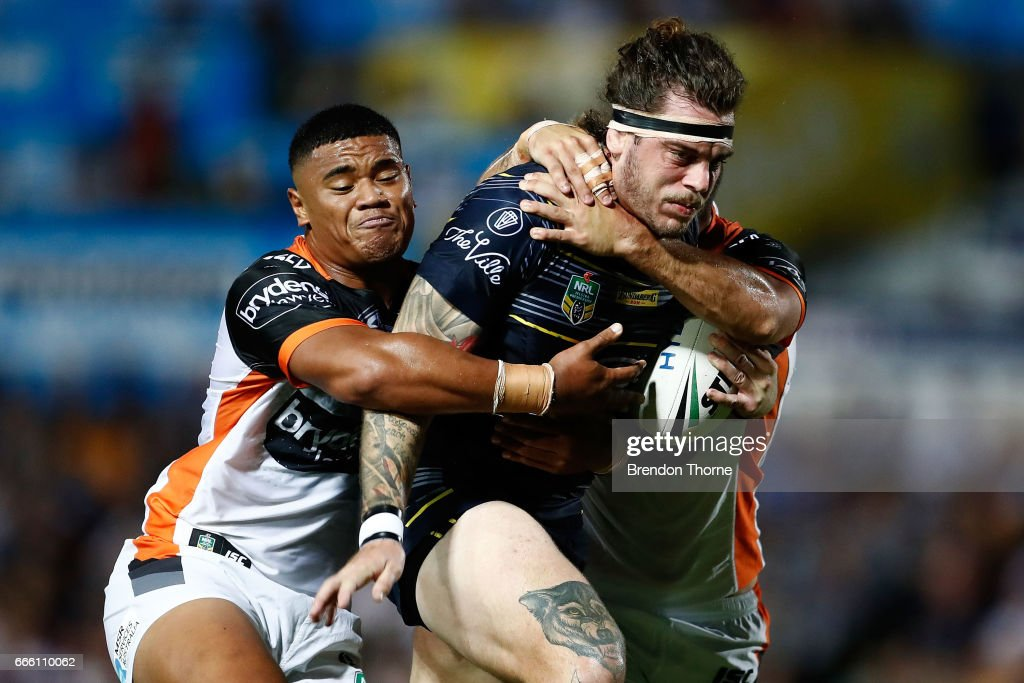 Ethan Lowe of the Cowboys is tackled by the Tigers defence during the round six NRL match between the North Queensland Cowboys and the Wests Tigers at 1300SMILES Stadium on April 8, 2017 in Townsville, Australia.