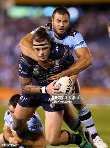 Ethan Lowe of the Cowboys is tackled by Wade Graham of the Sharks during the round 11 NRL match between the Cronulla Sharks and the North Queensland...
