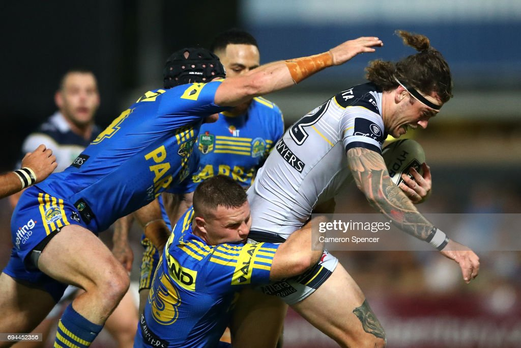 Ethan Lowe of the Cowboys is tackled during the round 14 NRL match between the Parramatta Eels and the North Queensland Cowboys at TIO Stadium on June 10, 2017 in Darwin, Australia.