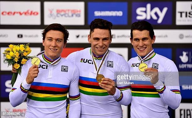 Ethan Mitchell Edward Dawkins and Sam Webster of New Zealand celebrate winning gold medal in the Mens Team Sprint race during the UCI Track Cycling...