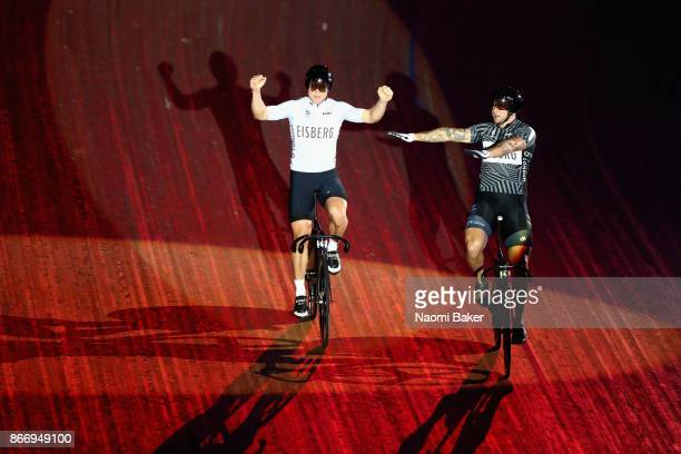 Ethan Mitchell of New Zealand wins the Sprint race ahead of Eddie Dawkins of New Zealand who bows down to him during the celebratory lap on Day 3 of...