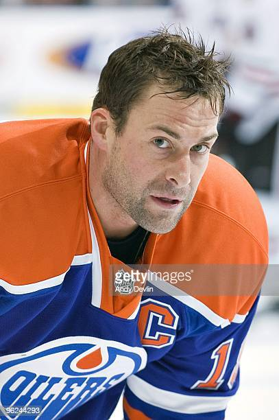 Ethan Moreau of the Edmonton Oilers watches his team warmup before a game against the Chicago Blackhawks at Rexall Place on January 26 2010 in...