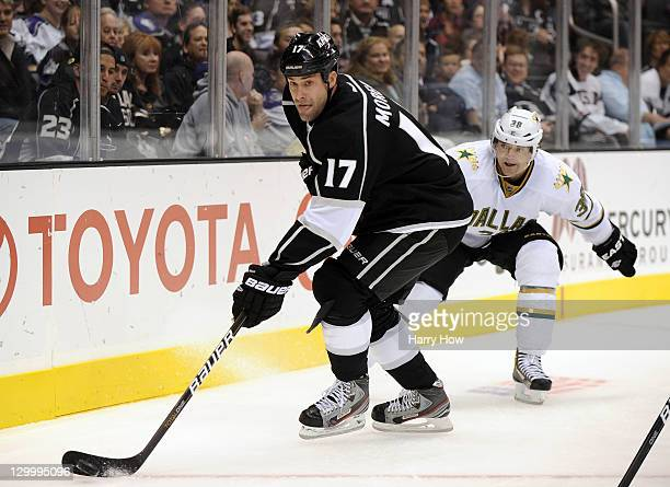 Ethan Moreau of the Los Angeles Kings looks to pass as he is watched by Vernon Fiddler of the Dallas Stars during the second period at Staples Center...