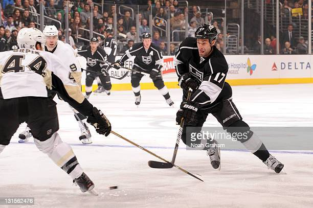 Ethan Moreau of the Los Angeles Kings makes a pass against Brooks Orpik of the Pittsburgh Penguins at Staples Center on November 5 2011 in Los...