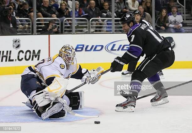 Ethan Moreau of the Los Angeles Kings pushes the puck wide of goaltender Anders Lindback of the Nashville Predators in the second period at Staples...