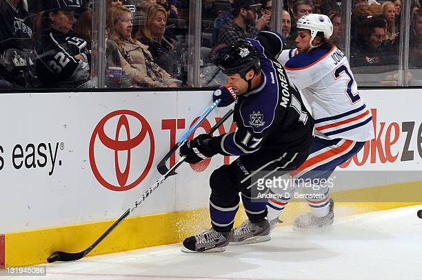 Ethan Moreau of the Los Angeles Kings skates with the puck against Ryan Jones of the Edmonton Oilers at Staples Center on November 3 2011 in Los...