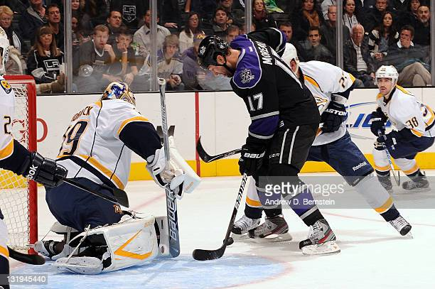 Ethan Moreau of the Los Angeles Kings tries to score against Anders Linback of the Nashville Predators at Staples Center on November 8 2011 in Los...