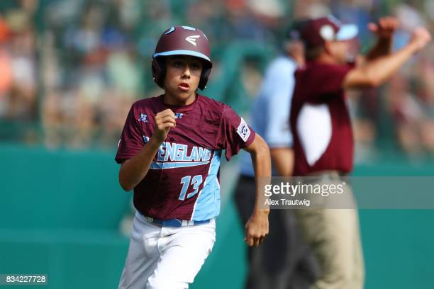Ethan Righter of the New England team from Connecticut runs home to score during Game 2 of the 2017 Little League World Series against the...